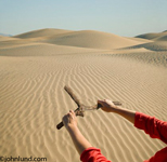 Woman's arms holding dowsing rod in a vast sand filled desert landscape